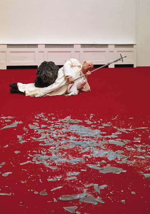 Maurizio Cattelan (b. 1960), La Nona Ora (The Ninth Hour), installation view, wax, clothing, polyester resin with metallic powder, volcanic rock, carpet, glass, dimensions variable