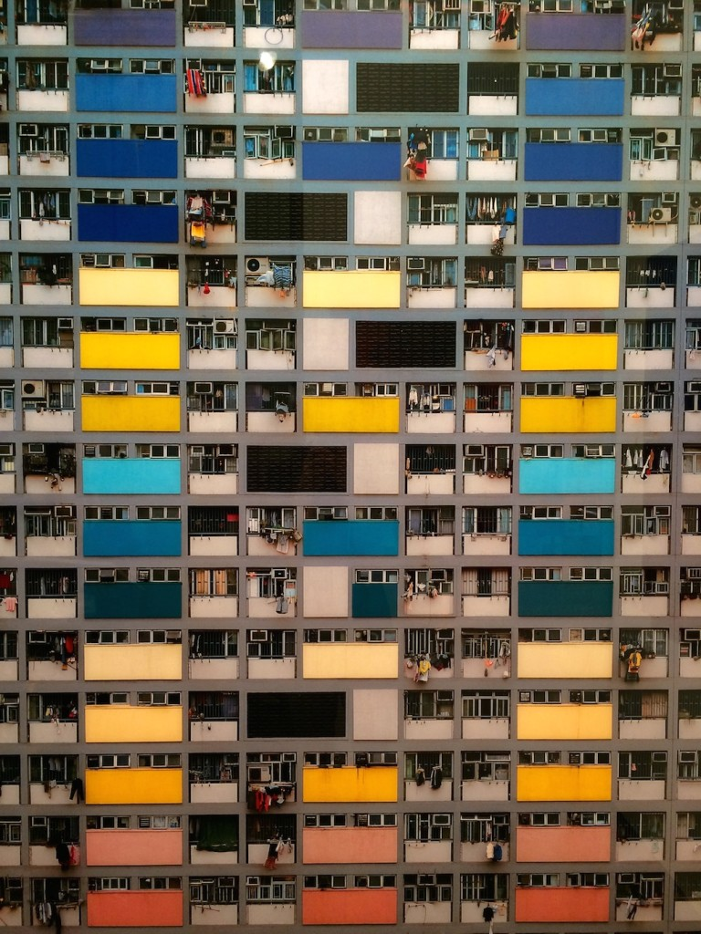 Michael Wolf, Architecture of Density 75, 2006; chromogenic print face-mounted to acrylic, 57 x 48 inches; installation view at Foster/White Gallery; photo © codylee.co
