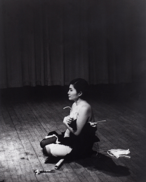 Yoko Ono, Cut Piece, 1964; performed by Yoko Ono in New Works of Yoko Ono, Carnegie Recital Hall, New York, March 21, 1965; photograph © Minoru Niizuma, courtesy of Lenono Photo Archive