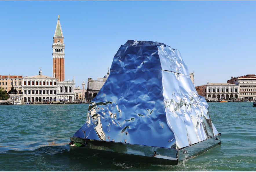 Helidon Xhixha, Iceberg, 2015; mirrored polished stainless steel, 157.5 x 118 inches; installation view at the 2015 Venice Biennale; image via Artsy