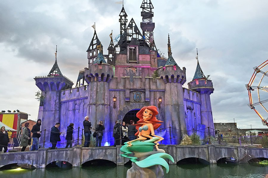 A distorted figure of the Little Mermaid. Installation view of a work by Banksy, Dismaland, 2015; photo by Carrie Seim for Architectural Digest