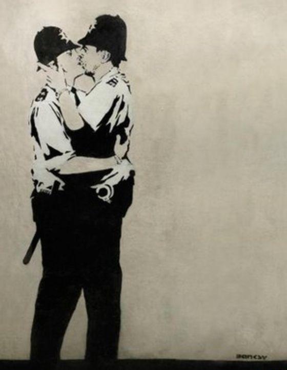 Banksy's Kissing Coppers; photo via BBC / Associated Press