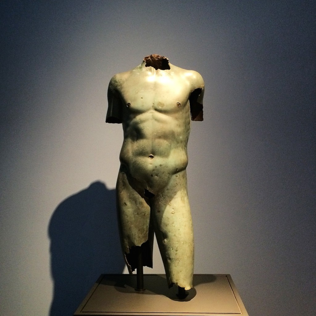"Torso of a Youth, ""The Vani Torso,"" 200–100 B.C. Bronze, 105 cm x 45 cm x 25 cm; Georgian National Museum, Vani Archaeological Museum-Reserve; Installation view of ""Power and Pathos"" at the Getty Museum, 2015; photo © codylee.co"