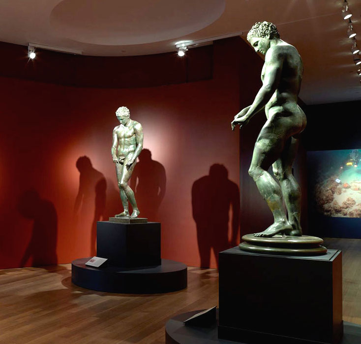"Gallery view of ""Power and Pathos"" at the Getty Museum, 2015; left to right: Athlete, 1-90 AD, Kunsthistorisches Museum Wien, Antikensammlung; Athlete, 100-1 BC, Republic of Croatia, Ministry of Culture; photo courtesy of The J. Paul Getty Museum"