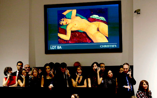 Christie's eployee's work the telephones during the auction of Amedeo Modigliani's 'Nu Couché' during the 'Artist's Muse: A Curated Evening Sale' at Christie's Auction House in New York on November 9, 2015; photo by European Pressphoto Agency