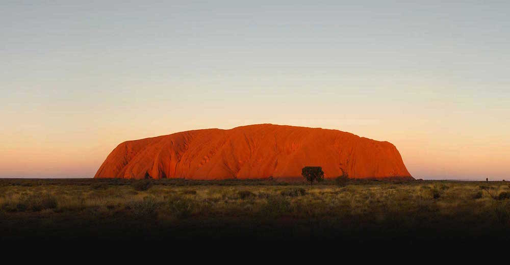 Ayers Rock / Uluru, Uluru-Kata Tjuta National Park, Australia; photo via Parks Australia